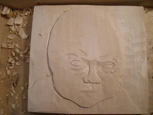 baby portrait wood carving